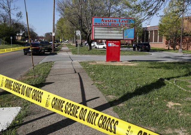 Knoxville police work the scene of a shooting at Austin-East Magnet High School Monday, April 12, 2021, in Knoxville, Tenn.