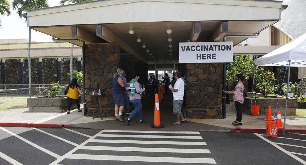 People line up to get COVID-19 vaccinations in Lihue, Hawaii, Wednesday, March 3, 2021.