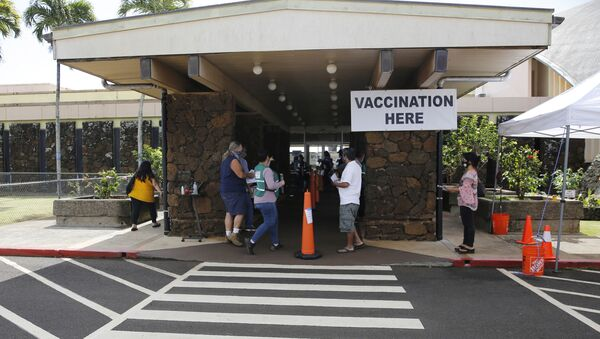 People line up to get COVID-19 vaccinations in Lihue, Hawaii, Wednesday, March 3, 2021. - Sputnik International
