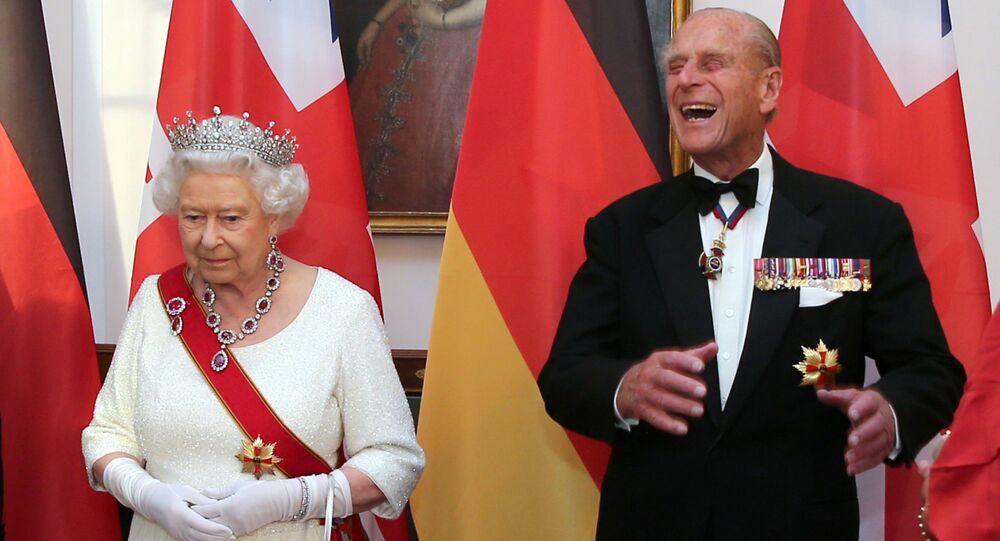 Britain's Queen Elizabeth and Prince Philip wait to greet guests prior to a state banquet at Bellevue presidential palace in Berlin, Germany June 24, 2015