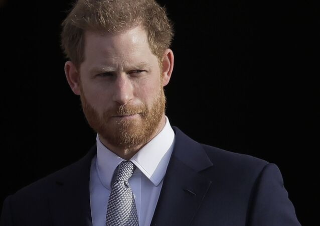 FILE - In this Thursday, Jan. 16, 2020,file photo, Britain's Prince Harry arrives in the gardens of Buckingham Palace in London