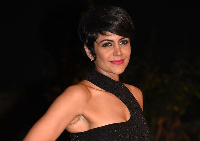 Indian Bollywood actress Mandira Bedi poses for photographs at the Grand Finale of Lakmй Fashion Week (LFW) Summer Resort 2019, in Mumbai on February 3, 2019