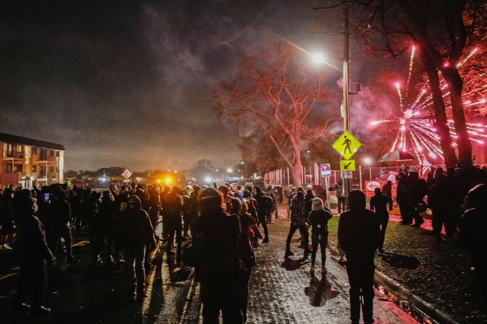 Protesters throw fireworks towards police as they gather outside the Brooklyn Center Police Department a day after Daunte Wright was shot and killed by a police officer, in Brooklyn Center, Minnesota, US, 12 April 2021.