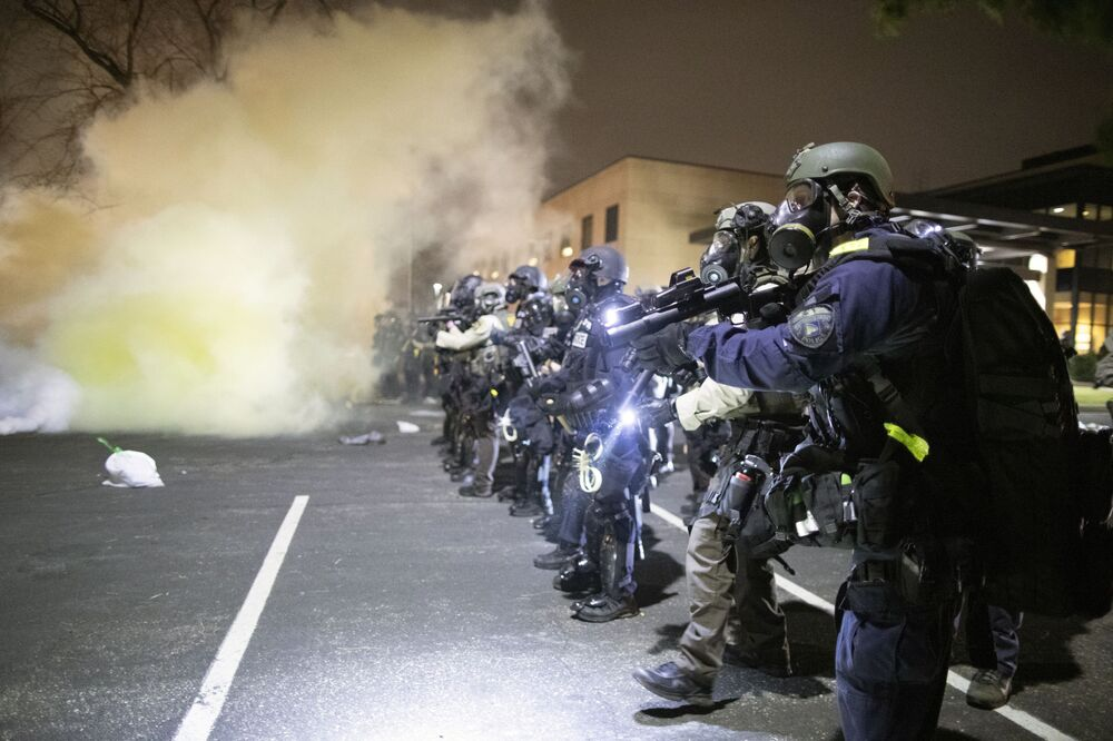 Police officers during a protest in downtown Brooklyn Center in the US state of Minnesota.