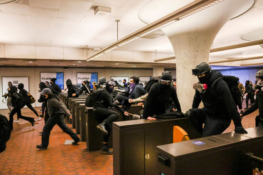 Protesters jump over the turnstiles at  the Gallery Place metro station during a protest following the fatal police shooting of 20-year-old Black man Daunte Wright in Minnesota, in Washington, US, 12 April 2021.