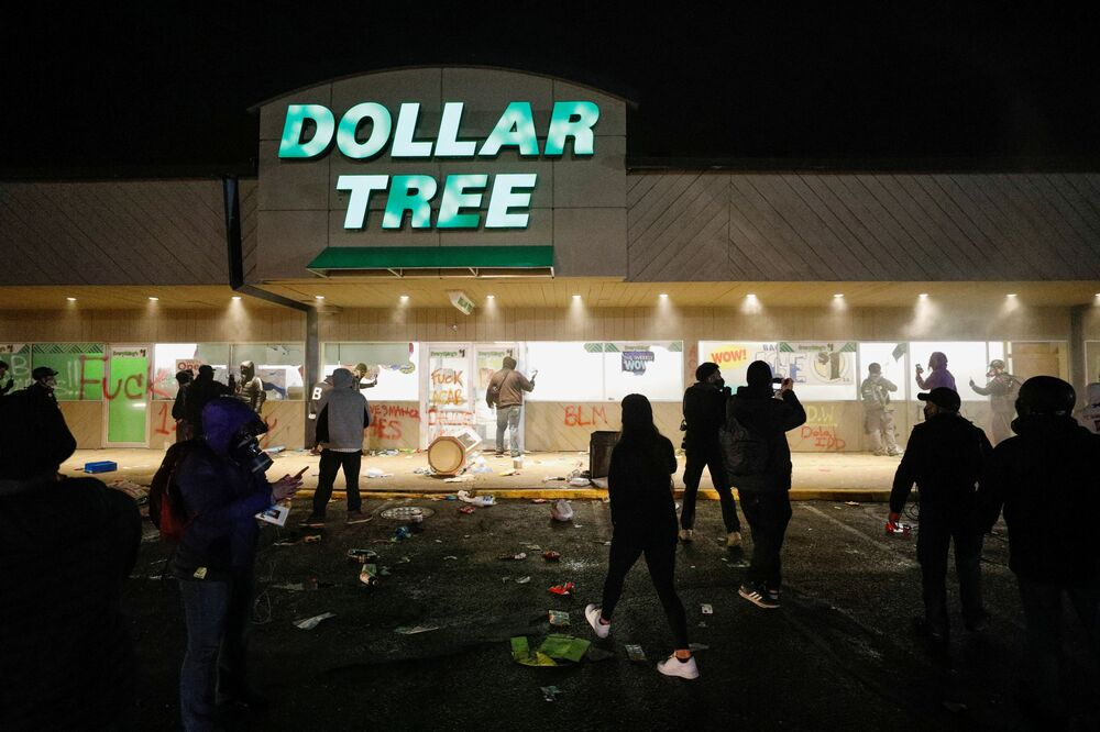 A Dollar Tree store that was looted has its sprinklers turned on as protesters gather outside Brooklyn Center Police Department a day after Daunte Wright was shot and killed by a police officer, in Brooklyn Center, Minnesota, US, 12 April 2021.
