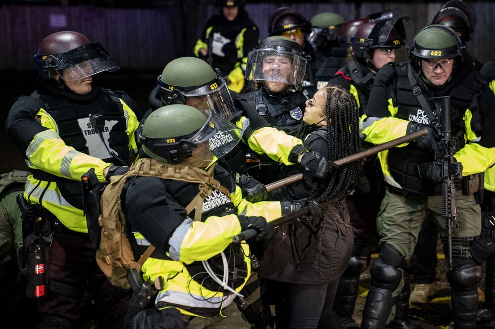 A demonstrator is arrested by police for violating curfew and an order to disperse during a protest against the police shooting of Daunte Wright, Monday, 12 April 2021, in Brooklyn Center, Minn.