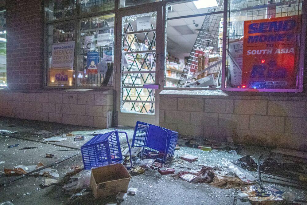 Broken shop windows in downtown Brooklyn Center, Minnesota.