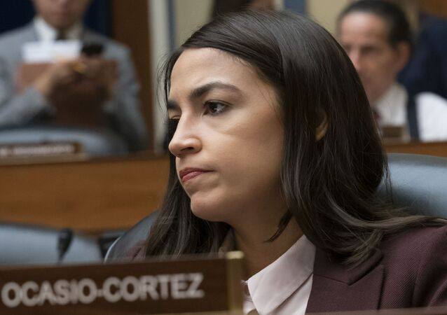 Rep. Alexandria Ocasio-Cortez, D-N.Y., attends a House Oversight Committee hearing on high prescription drugs prices shortly after her private meeting with Speaker of the House Nancy Pelosi, D-Calif., on Capitol Hill in Washington, 26 July 2019