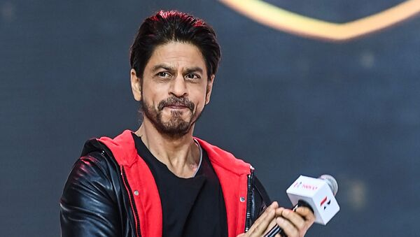 Bollywood actor Shah Rukh Khan gestures as he speaks during the unveiling of the company's 100 millionth motorcycle, in Gurgaon on January 21, 2021 - Sputnik International