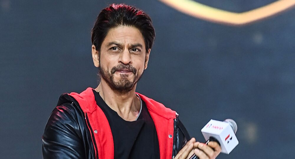 Bollywood actor Shah Rukh Khan gestures as he speaks during the unveiling of the company's 100 millionth motorcycle, in Gurgaon on January 21, 2021