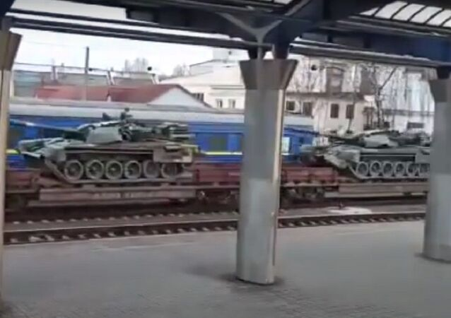Battle tanks T-72AMT of the Armed Forces of Ukraine from the Dnepropetrovsk railway go in the direction of Donbass