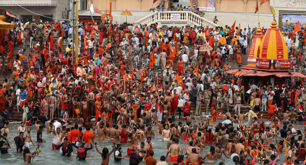 SENSITIVE MATERIAL. THIS IMAGE MAY OFFEND OR DISTURB    Naga Sadhus, or Hindu holy men, take a dip in the Ganges river during the second Shahi Snan at Kumbh Mela, or the Pitcher Festival, amid the spread of the coronavirus disease (COVID-19), in Haridwar, India, April 12, 2021.