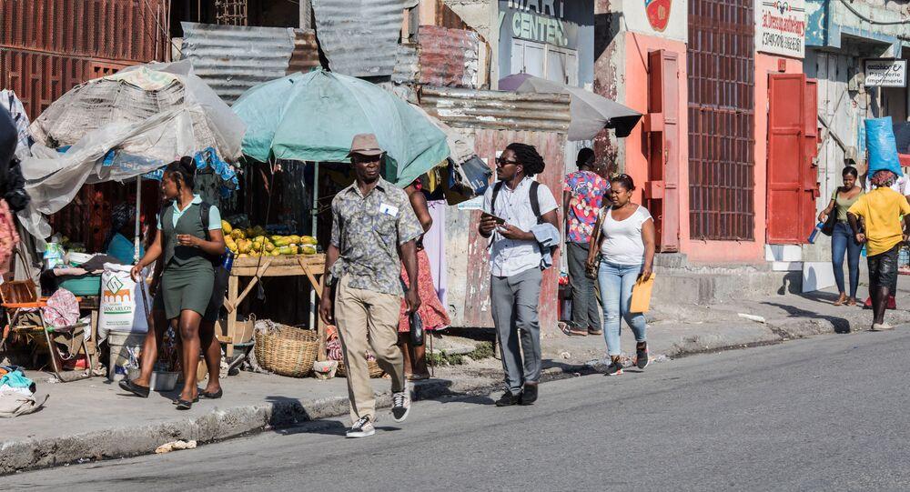 People walk down a street of Port-au-Prince on 12 April 2021
