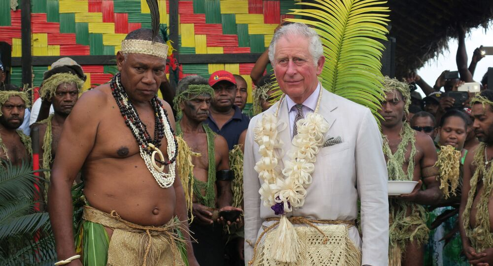 Britain's Prince Charles (R) stands with Chief Seni Mao Tirsupe, the President of the Malvatumauri Council of Chiefs, at the Chief's Nakamal in Port Vila on April 7, 2018