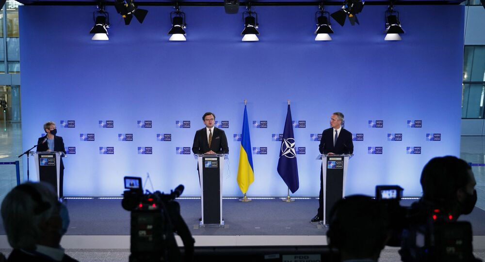 NATO Secretary General Jens Stoltenberg (R) and Ukraine's Foreign Minister Dmytro Kuleba give a press conference following their meeting at NATO headquarters in Brussels, on April 13, 2021.