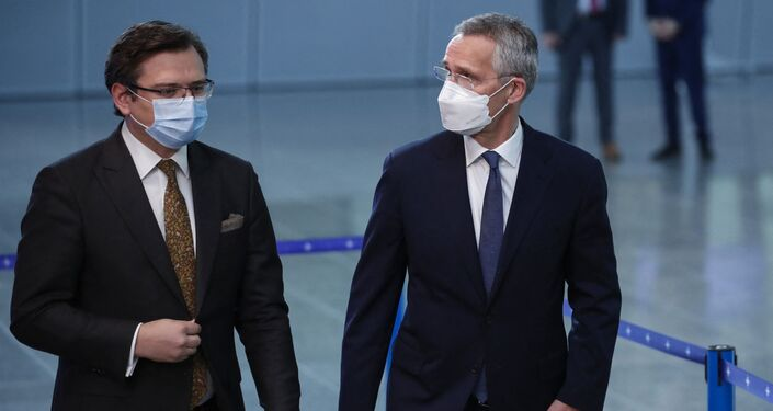 NATO Secretary General Jens Stoltenberg (R) welcomes Ukraine's Foreign Minister Dmytro Kuleba prior to a meeting at NATO headquarters in Brussels, on April 13, 2021.