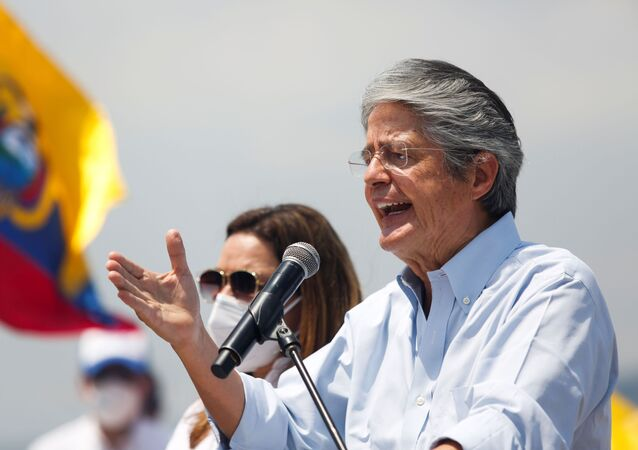 Ecuador's presidential candidate Guillermo Lasso gestures as he speaks during a closing campaign rally, in Guayaquil, Ecuador April 8, 2021.