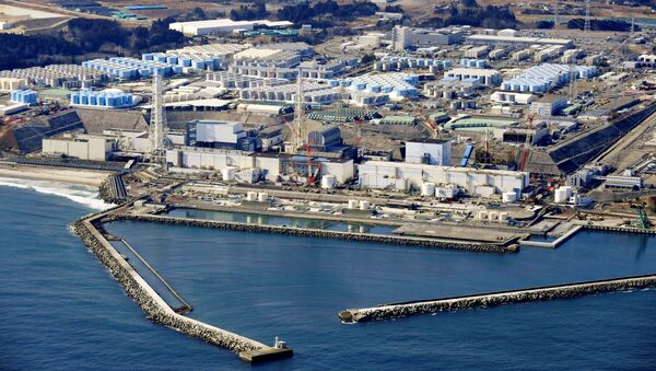 An aerial view shows the storage tanks for treated water at the tsunami-crippled Fukushima Daiichi nuclear power plant in Okuma town, Fukushima prefecture, Japan February 13, 2021, in this photo taken by Kyodo. - Sputnik International