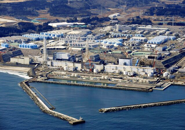 An aerial view shows the storage tanks for treated water at the tsunami-crippled Fukushima Daiichi nuclear power plant in Okuma town, Fukushima prefecture, Japan February 13, 2021, in this photo taken by Kyodo.