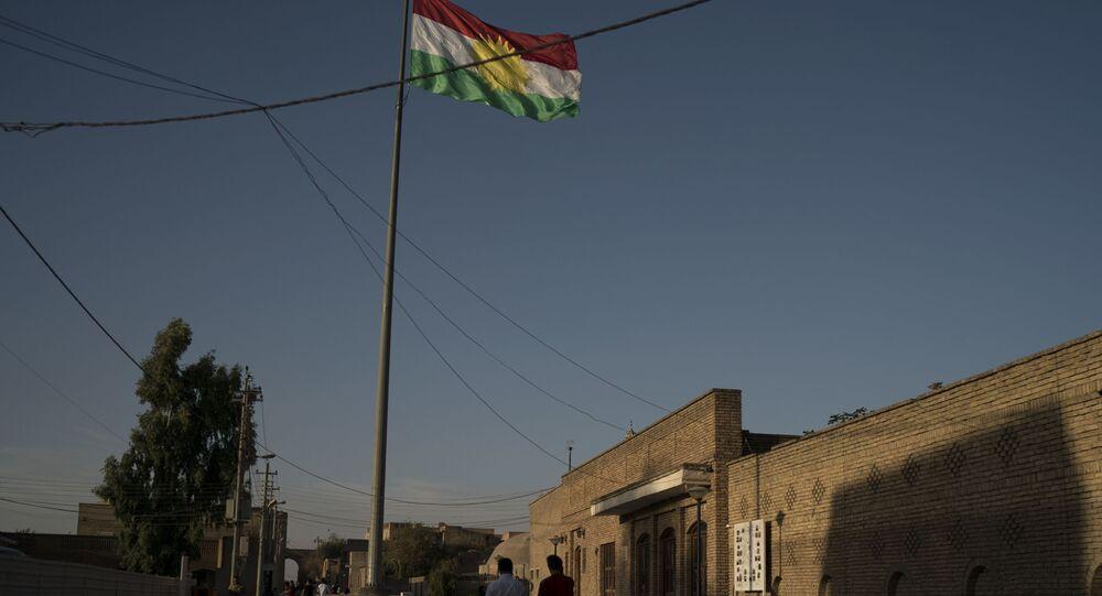 A Kurdish flag waves inside the Irbil's citadel in central Irbil, Iraq, Saturday, Oct. 21, 2017.