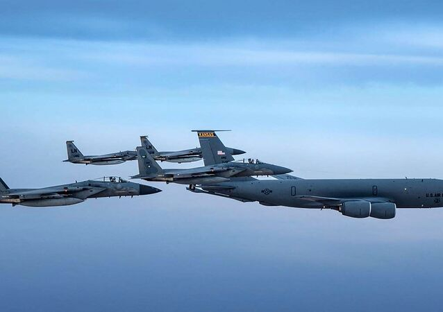A handout picture provided by the Saudi Ministry of Defence on June 16, 2019 shows Saudi F-15 Eagles flying in formation with their US Air Force counterparts and a USAF KC-135 Stratotanker jet (R) in the US CENTCOM area of responsibility, on June 2.