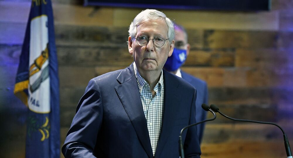 Senate Minority Leader Mitch McConnell, R-Ky., listens to a reporter's question during a news conference at a COVID-19 vaccination site in Lexington, Ky., Monday, April 5, 2021.