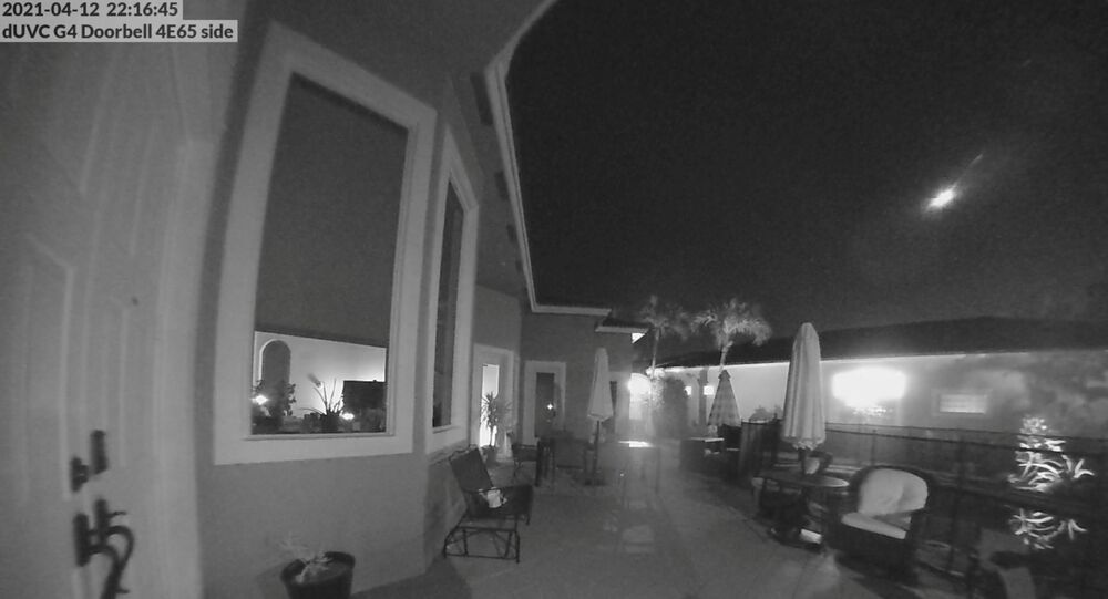 A meteor is seen moving across Florida sky, in Parkland, Florida, U.S., April 12, 2021 in this still image obtained from a social media video.