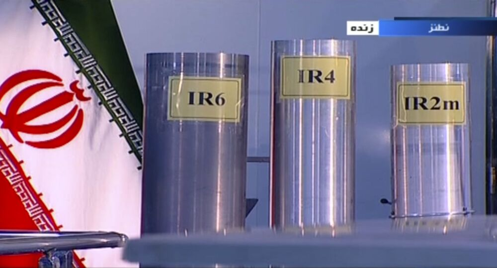 In this June 6, 2018 frame grab from Islamic Republic Iran Broadcasting, IRIB, state-run TV, three versions of domestically-built centrifuges are shown in a live TV program from Natanz, an Iranian uranium enrichment plant, in Iran