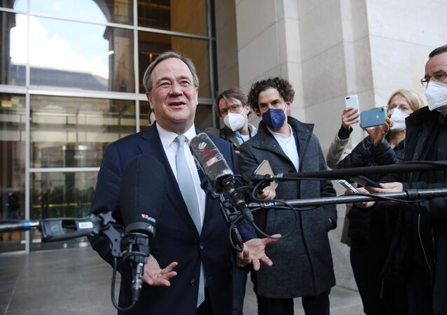 North Rhine-Westphalia's State Premier and head of Germany's conservative Christian Democratic Union (CDU) party Armin Laschet speaks to the media as he leaves after a CDU/CSU fraction meeting in Berlin, Germany April 13, 2021
