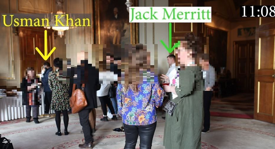 Usman Khan is pictured collecting his brunch buffet as Jack Merritt, one of his victims, waits behind him in the queue