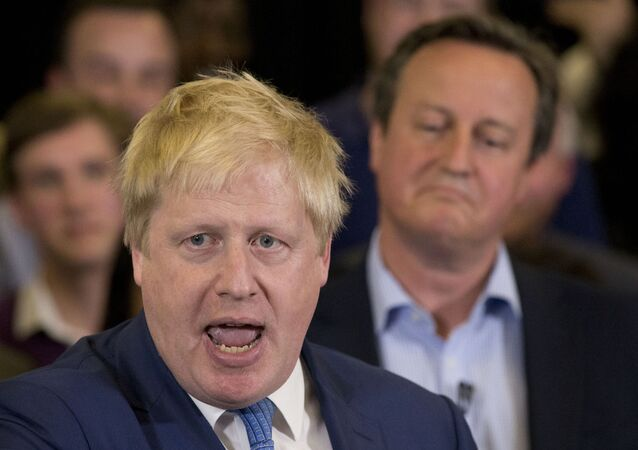 In this Tuesday, May 3, 2016 file photo Britain's Prime Minister David Cameron, right, listens as then Mayor of London Boris Johnson speaks at a mayoral election campaign rally for Britain's Conservative party candidate for Mayor of London Zac Goldsmith at a school in Ham, a suburb in south west London