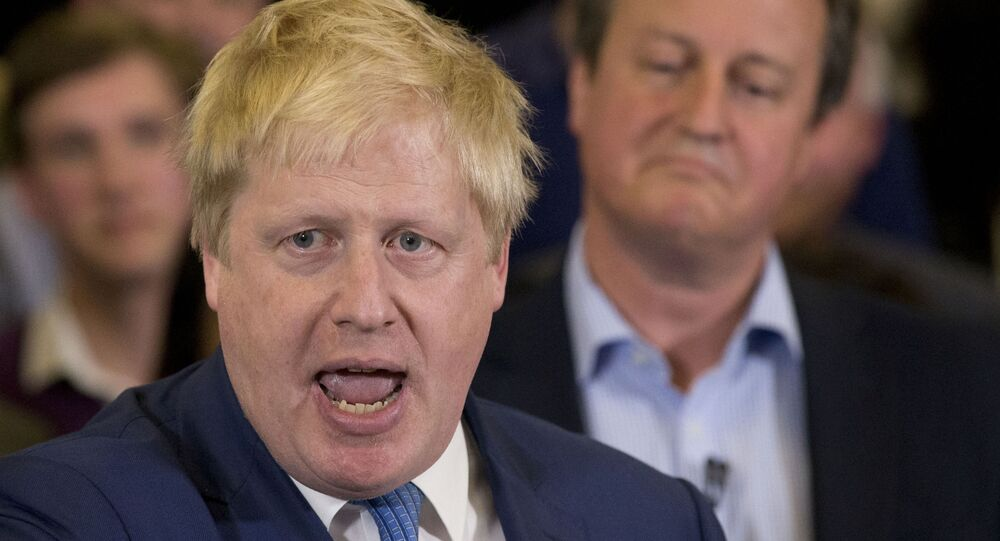 In this Tuesday, 3 May 2016 file photo Britain's Prime Minister David Cameron, right, listens as then Mayor of London Boris Johnson speaks at a mayoral election campaign rally for Britain's Conservative party candidate for Mayor of London Zac Goldsmith at a school in Ham, a suburb in southwest London