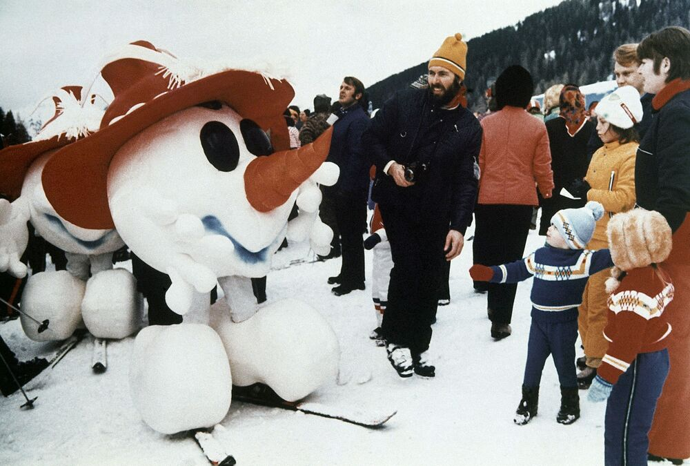 These Disney-style Tyrolean characters appeared for the first time at Kitzbuhel, Austria during the world downhill ski events, January 1975. They represented the official Mascot for the Winter Olympic Games, held around Innsbruck, Austria, 1976.