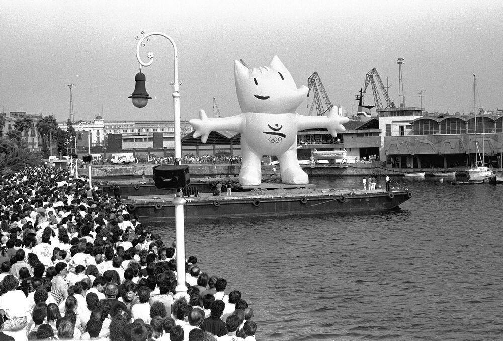 Cobi, official mascot of the 1992 Summer Olympic Games in Barcelona, comes up to the surface in Barcelona's Port during the celebration of the arrival of the Olympic Flag, .