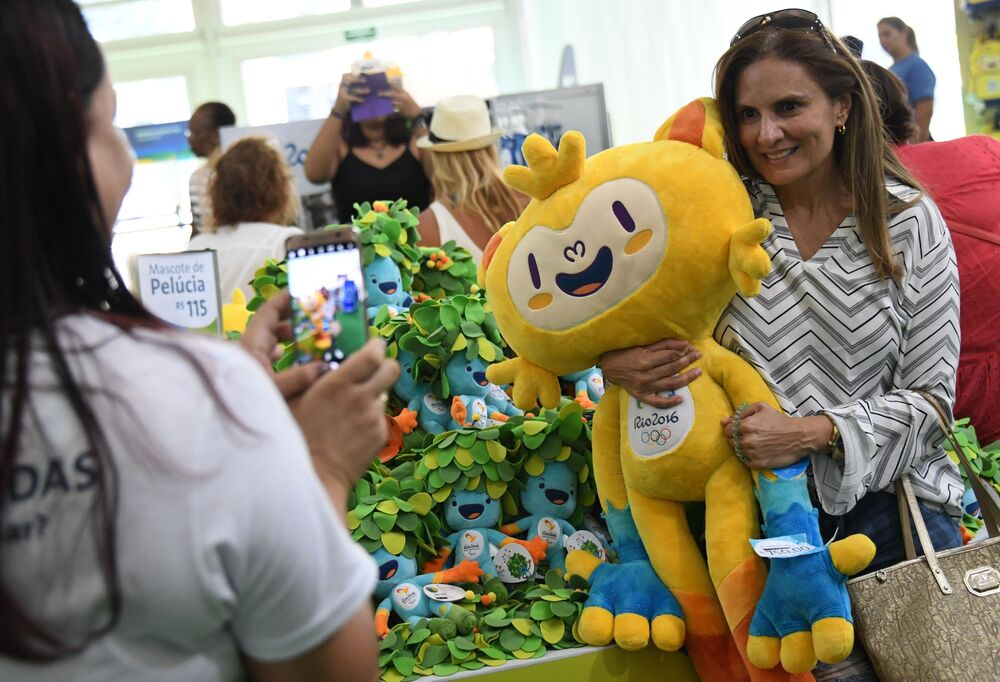 Shoppers examine Vinicius des Moraes, a blend of native Brazilian animals, who was designed for the Olympic Games Rio 2016.