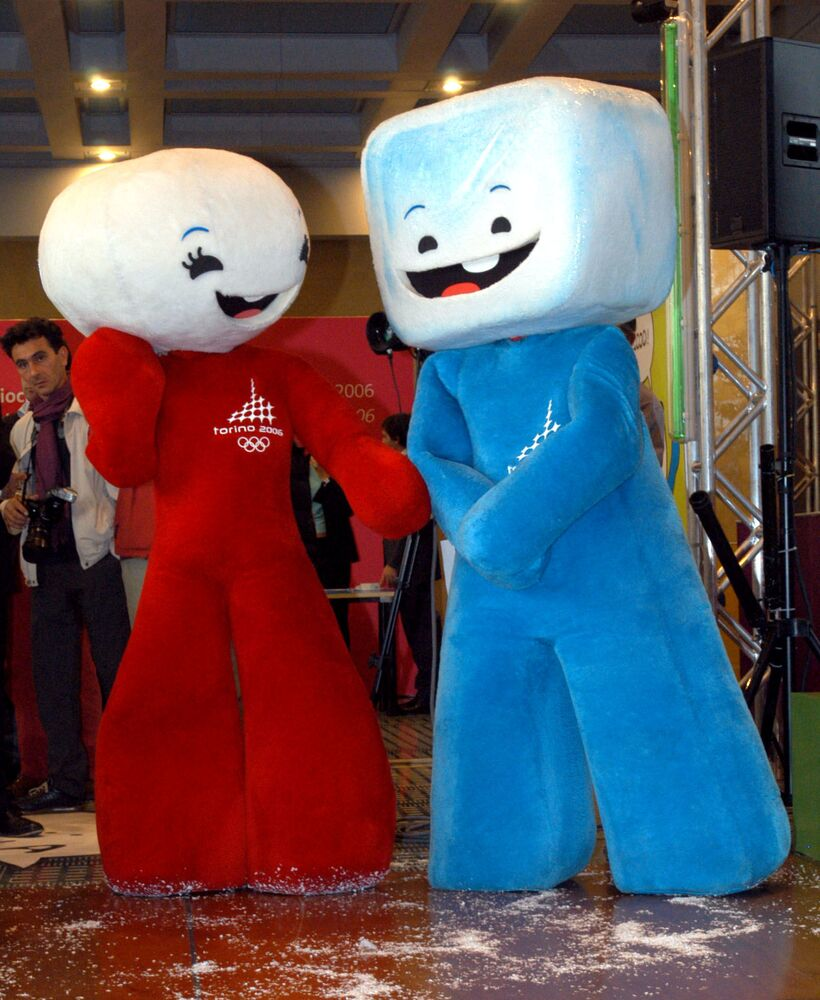 The 2006 Turin Winter Olympic mascots Neve, at left, and Gliz perform during their presentation in Rome, 28 September 2004. The Olympic mascots, representing a ball of snow and a block of ice, were designed by Portuguese designer Pedro Albuquerque.