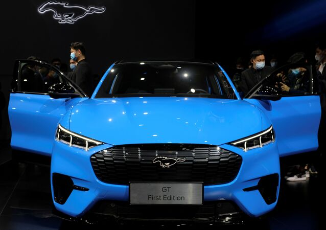 Visitors check on a Ford Mustang Mach-E electric vehicle displayed at a launch event in Shanghai, China April 13, 2021