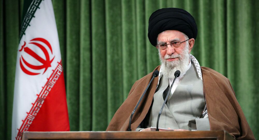 In this picture released by the official website of the office of the Iranian supreme leader, Supreme Leader Ayatollah Ali Khamenei addresses the nation in a televised speech marking the Iranian New Year, in Tehran, Iran, Sunday, March 21, 2021.