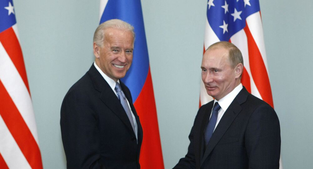 In this March 10, 2011, file photo, Vice President of the United States Joe Biden, left, shakes hands with Russian Prime Minister Vladimir Putin in Moscow, Russia.