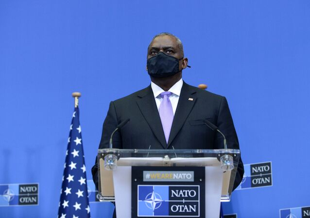 US Secretary of Defense Lloyd Austin looks on during a joint news conference with NATO Secretary General Jens Stoltenberg and U.S. Secretary of State Antony Blinken, following a meeting after the US announced the withdrawal of all its troops from Afghanistan by 11 September 2021, at NATO's headquarters in Brussels, Belgium, 14 April 2021.