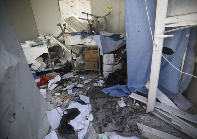 Damage from shelling is seen in hospital in Atareb, a town in rural western Aleppo, Syria, Sunday, March 22, 2021.
