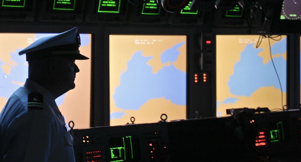 In this Tuesday, June 7, 2011 file photo, a US Navy officer, name not available, stands on the weapons control deck of the USS Monterey as screens display the Black Sea region, in the Black Sea port of Constanta, Romania.