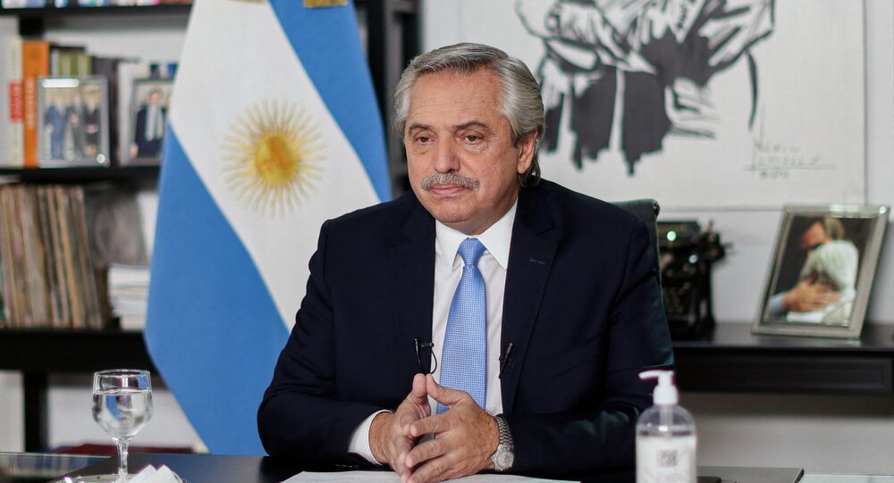 Handout picture released by Argentina's Presidency showing Argentine President Alberto Fernandez announcing new measures against the spread of the novel coronavirus, COVID-19, from Olivos Presidential Residence in Olivos, Buenos Aires, on April 14, 2021.