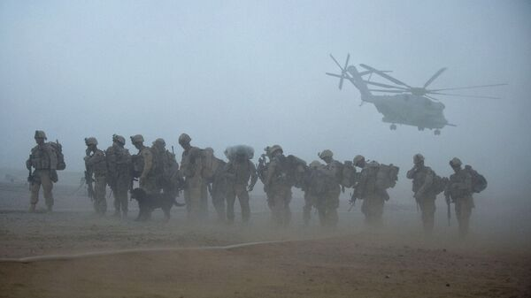 In this file photo US Marines from the 2nd Battalion, 8th Marine Regiment of the 2nd Marine Expeditionary Brigade wait for helicopter transport as part of Operation Khanjar at Camp Dwyer in Helmand Province in Afghanistan on July 2, 2009. - Sputnik International