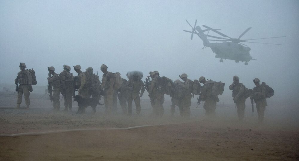 In this file photo US Marines from the 2nd Battalion, 8th Marine Regiment of the 2nd Marine Expeditionary Brigade wait for helicopter transport as part of Operation Khanjar at Camp Dwyer in Helmand Province in Afghanistan on July 2, 2009.