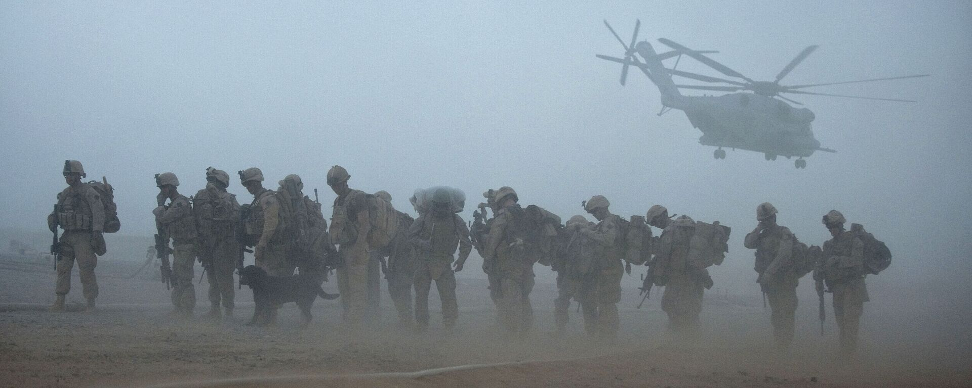 In this file photo US Marines from the 2nd Battalion, 8th Marine Regiment of the 2nd Marine Expeditionary Brigade wait for helicopter transport as part of Operation Khanjar at Camp Dwyer in Helmand Province in Afghanistan on July 2, 2009. - Sputnik International, 1920, 28.07.2021