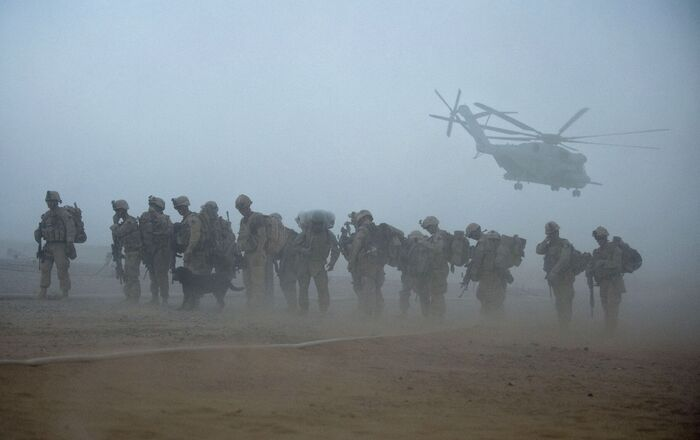 In this file photo US Marines from the 2nd Battalion, 8th Marine Regiment of the 2nd Marine Expeditionary Brigade wait for helicopter transport as part of Operation Khanjar at Camp Dwyer in Helmand Province in Afghanistan on 2 July 2009.