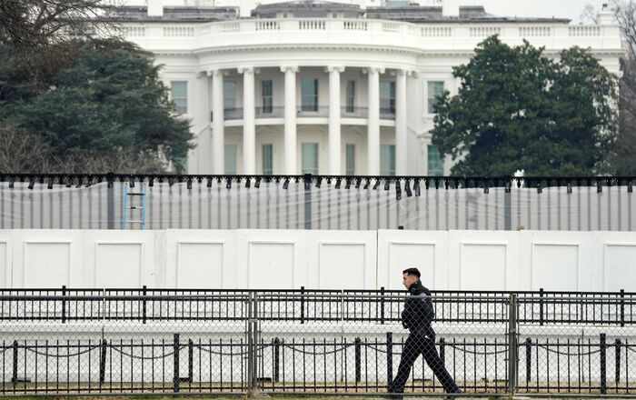 A member of the Secret Service walks along security fence installed around the White House days after supporters of U.S. President Donald Trump stormed the Capitol in Washington, U.S., January 11, 2021.