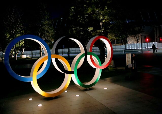 The Olympic rings are illuminated in front of the National Stadium in Tokyo, Japan January 22, 2021.